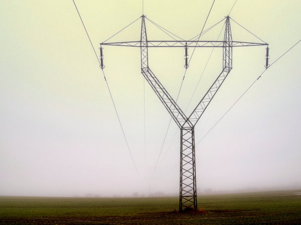 Power grid - HDR: Power cables in a misty morning light.