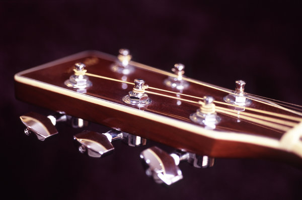 guitar headstock: close up on a guitar headstock and tuning pegs
