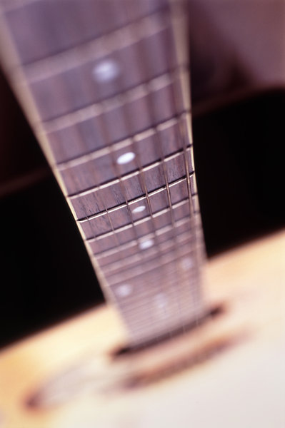 guitar strings: strings of an acoustic guitar