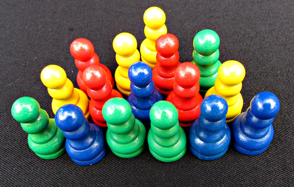 In The Game Various Coloured Games Pieces Or Components