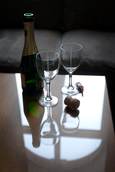 Sparkling Wine: Drinking delicious white sparkling wine in a hotel room