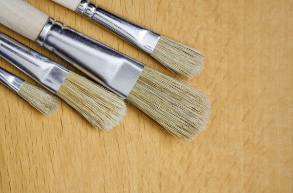 Brushes on wooden background: brushes on light wood