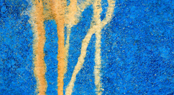 Dripping paint texture: dripping paint on blue grunge background