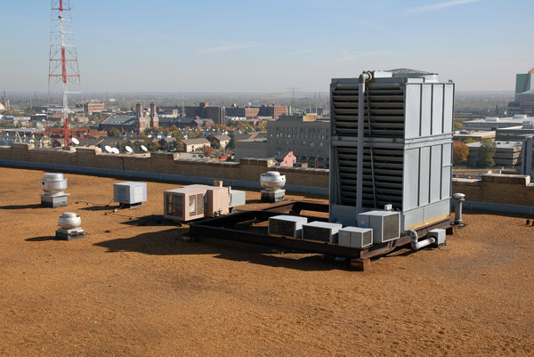 Air Conditioner: Air conditioner on the roof of a building.