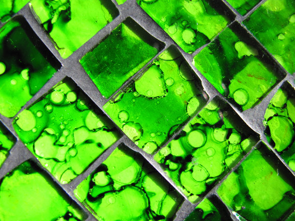 green glass mosaic 1: close-up on green glass stones