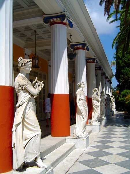 Greek Columns: red-white-blue greek columns and statues in achilleion palace, corfu