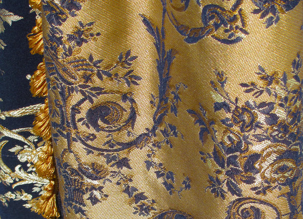 Brocade: Blue/gold coloured brocade curtain detail