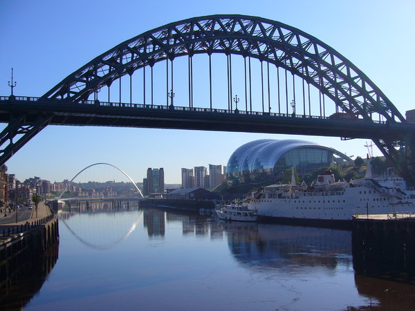 Bridges of the Tyne 2: A series of views showing the bridges over the River Tyne that link Newcastle and Gateshead.Many Tyneside landmarks can be seen in this picture. In the foreground is the famous Tyne Bridge, with the Gateshead Millennium Bridge behind. On the right bank (t