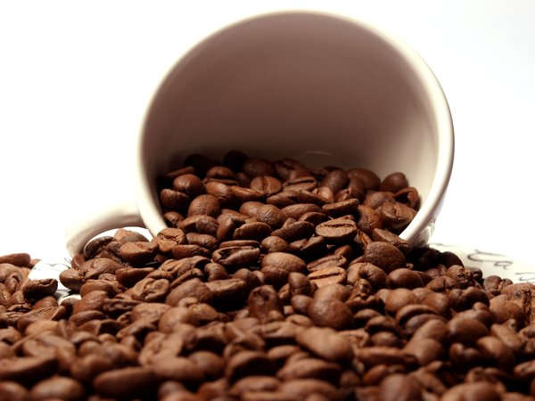 Coffee beans: A coffee cup pouring coffee beans