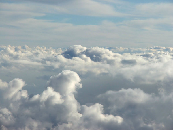 between the clouds: clouds seen through plane window during flight
