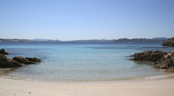 Perfect beach: A tiny beach by the clear waters of the Maddalena Islands, Sardinia.