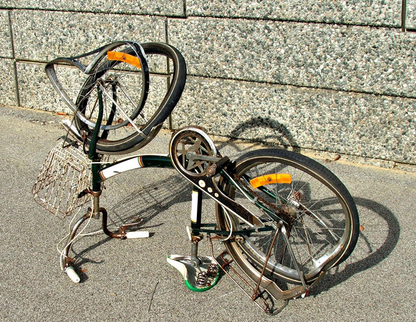 out of shape: damaged bicycle upturned for closer inspection