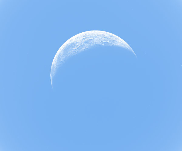 Crescent Moon on Blue: A realistic crescent moon on a light blue background. You may prefer this:  http://www.rgbstock.com/photo/nY4Is7U/Crescent+Moon+and+Star