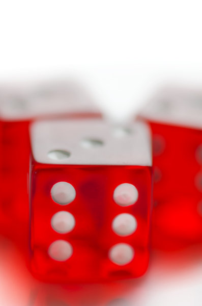 Red dice on white background: red shiny dice