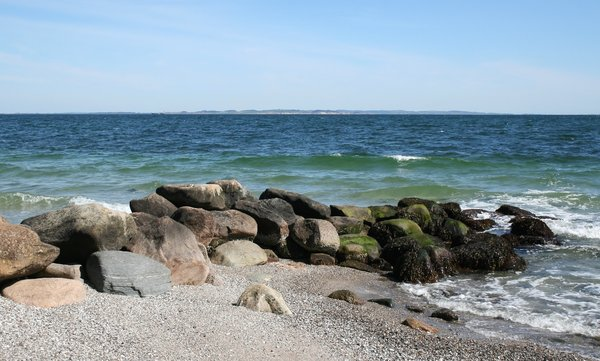 Breakwater: A breakwater on the coast of Denmark in spring.