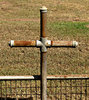 rusty plumber's cross