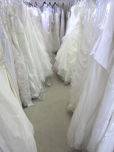 Wedding Dresses: Wedding dresses in a shop.