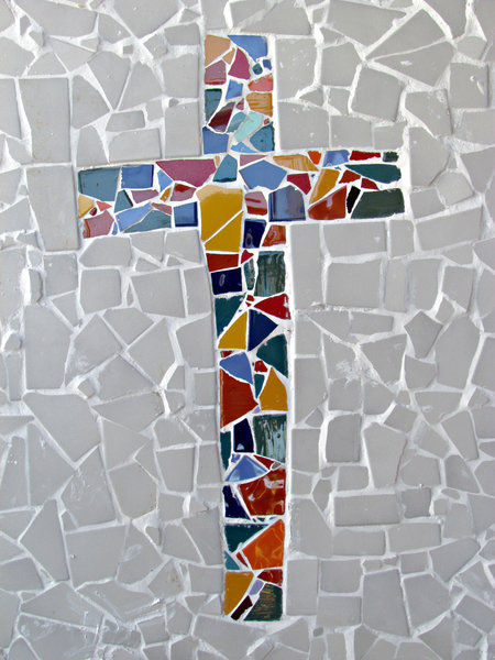 mosaic cross: broken tile chips mosaic work needing final clean-up work