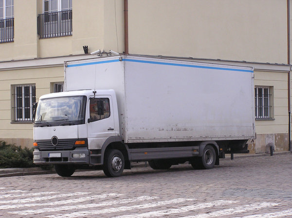 A truck on a street: Delivery truck.