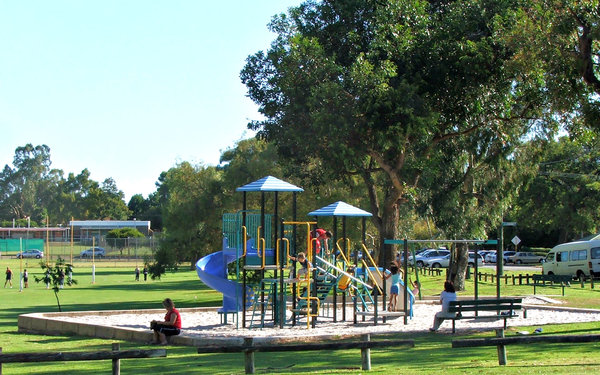 children's playground: children playing on playground equipment in local recreational area