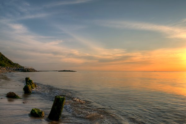 Breakwater - HDR: Breakwater with seaweed at the coast in sunset light. The image is HDR.