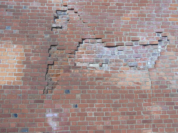 Wall: A cracked wall.