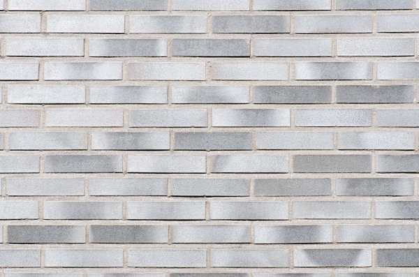 Grey brick wall: detailed brick wall