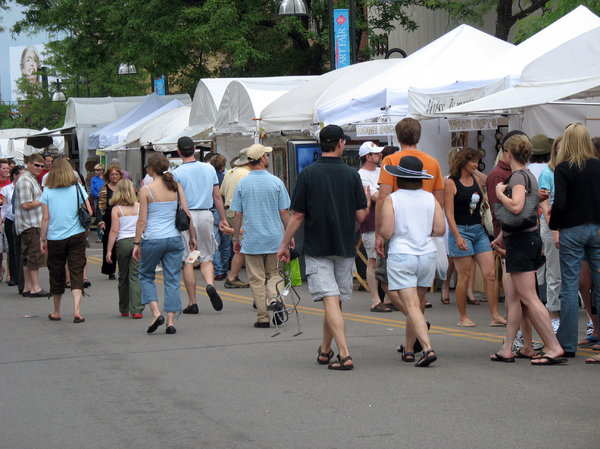 art fair: people strolling the edina art fair.