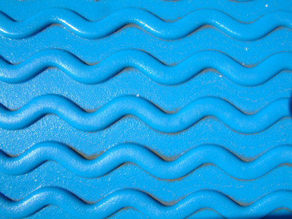 Blue Waves: Wave texture on a seat of a children's swing