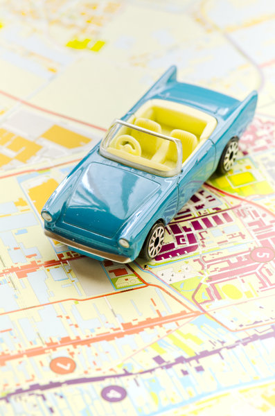 Car on map: Blue toy car on map