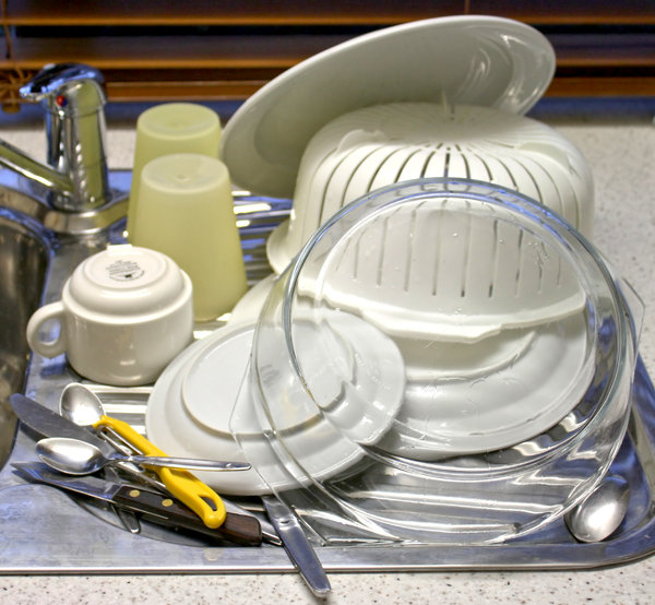 The Dishes are Done: A pile of washed dishes, cups, cutlery and a bowl.