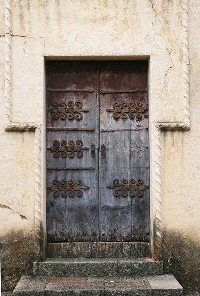 Grunge Spanish door: An old battered door in a town in Spain.