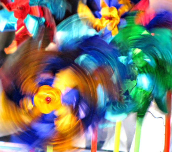 swirling colour: spinning colorful toy wind wheels