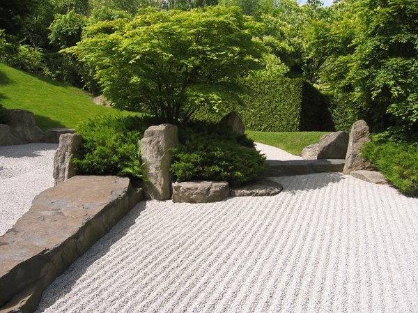 japanese garden: Unlike other traditional gardens, there is no real water present in Karesansui gardens. However, there is raked gravel or sand that simulates the feeling of water.