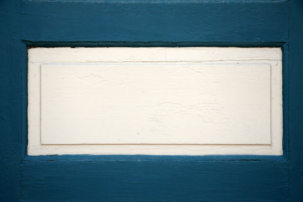 White Panel: A white panel in a blue door.