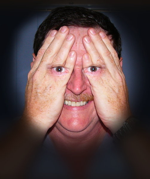 I can still see you...2: A spooky image of a man hiding his face, but his eyes are visible through his hands. Has a scary smile and a strange expression in his eyes. Can represent a spy or the NSA. You may prefer:  http://www.rgbstock.com/photo/nbtIPzU/I+can+still+see+you...3