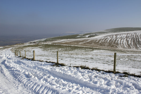 Snowy track: A farm track on the South Downs, West Sussex, England, under snow.