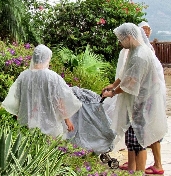 plastic coverup1B: inexpensive plastic rain-cape protection from rainy