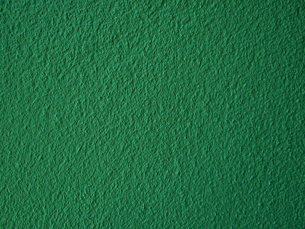 green textured wall surface: textured green wall