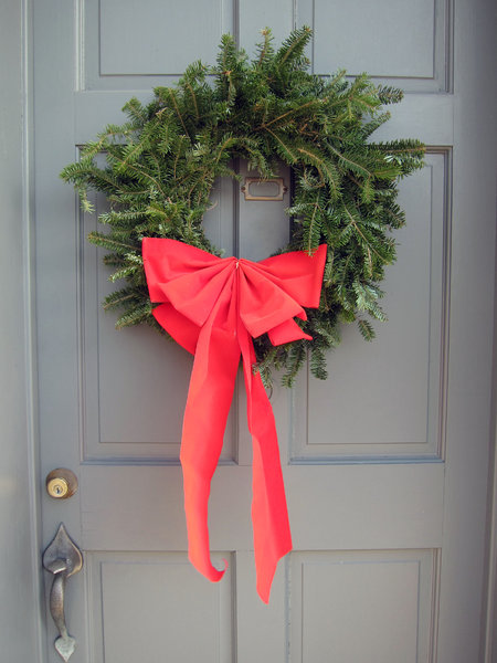 Wreath: A Christmas wreath on a door.
