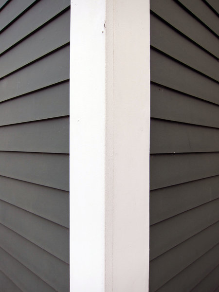 Siding: Overlap wood siding on a only house.