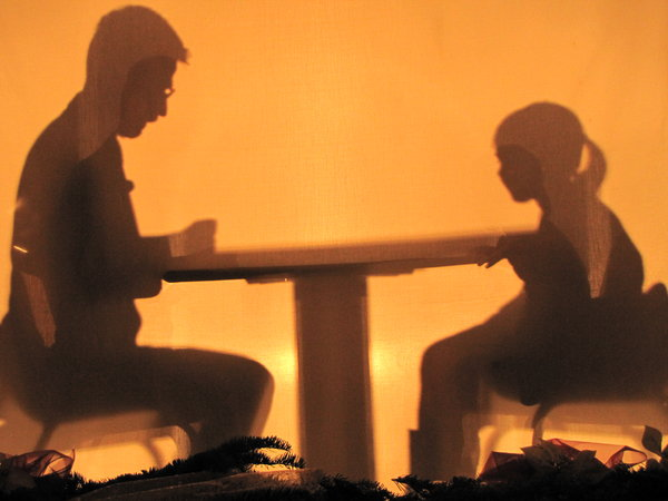 shadows: man and a child behind a screen