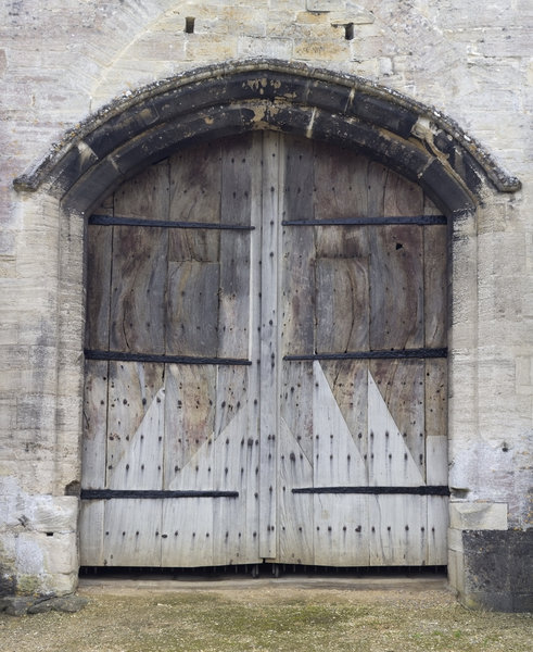 Ancient barn doors: Doors of an ancient tithe barn at Bradford-on-Avon, England. The barn belongs to a charitable trust that freely permits photography.