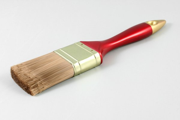Paint Brush: Close-up of a paint brush isolated on a white background.