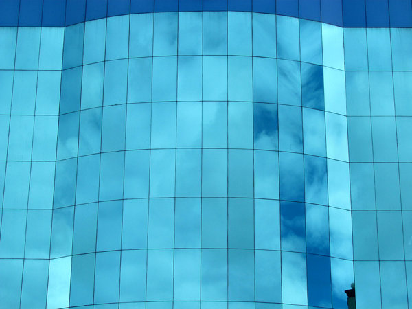 blue glass reflections1: external blue glass panels reflecting blue sky and clouds