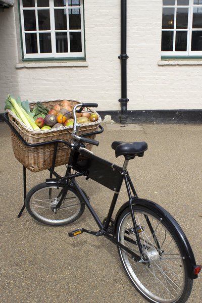 Greengrocer's bicycle: A greengrocer's bicycle with a selection of fruits and vegetables in Surrey, England.