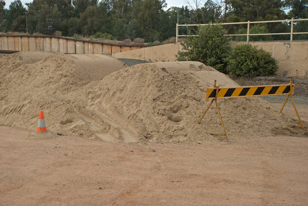 nature: a pile of sand with warning equipment