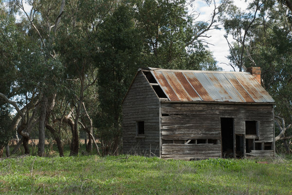 rural: an old rundown house on farm property