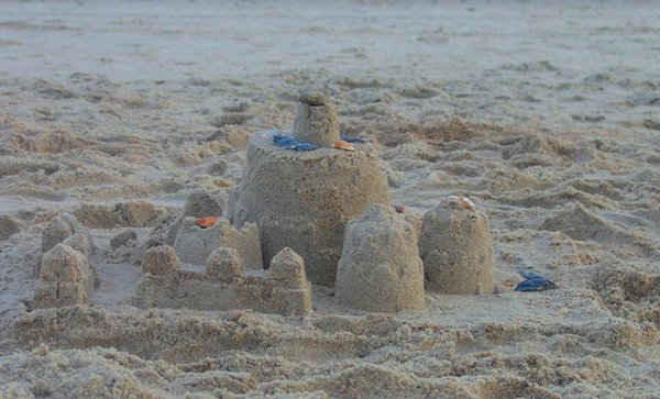 Shells & Sandcastle: Sandcastle with seashells adorning top, beachside Atlantic Ocean.