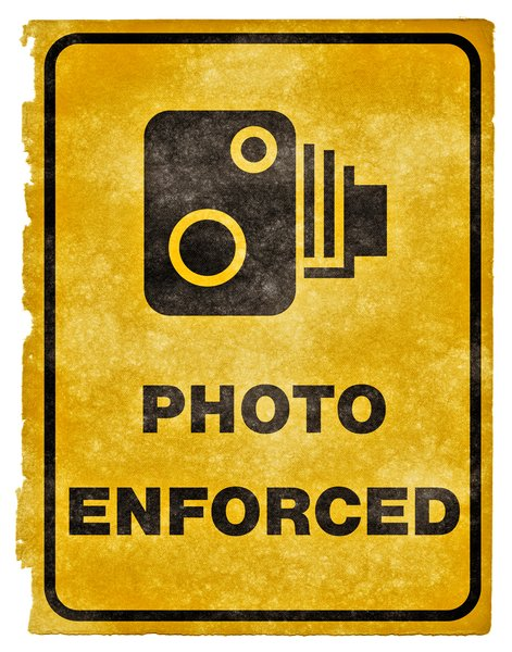 Photo Enforced Grunge Sign: Grunge textured PHOTO ENFORCED sign on vintage paper.